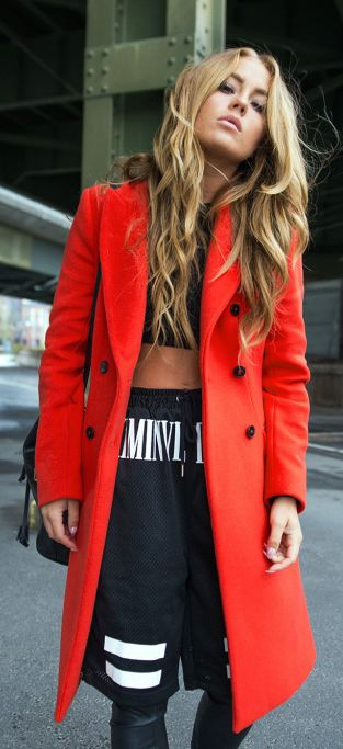 Angelica Blick is wearing a red long coat from Zara in November 2014