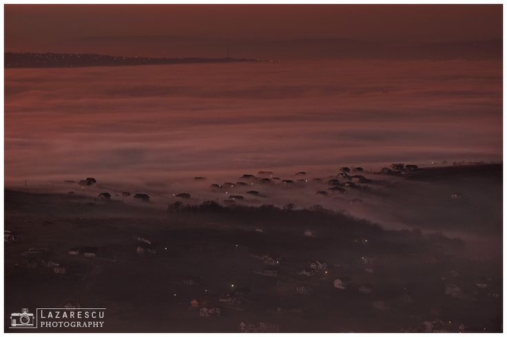 River of fog - Flowing of fog over the village at sunset moment.