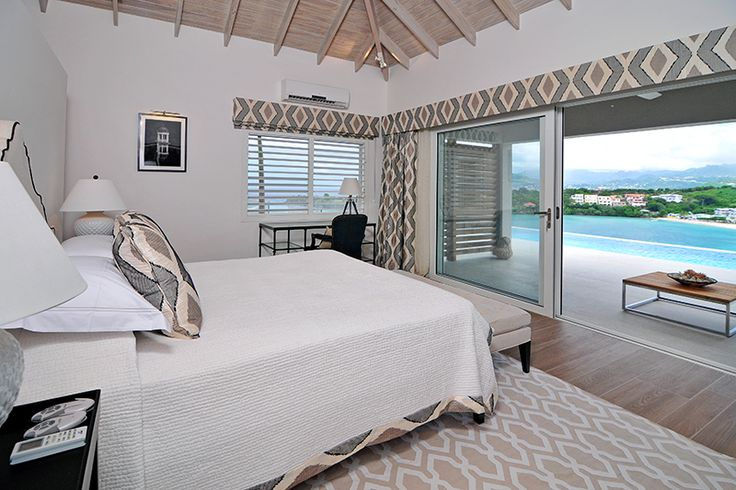 Grenada Villas, for rent or sale. Master Bedroom features chic styling and Caribbean Sea views.
