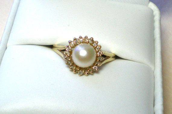 Vintage pearl ring with diamonds white pearl set in a surround of diamond accents 10k yellow gold ring size 7 excellent vintage condition