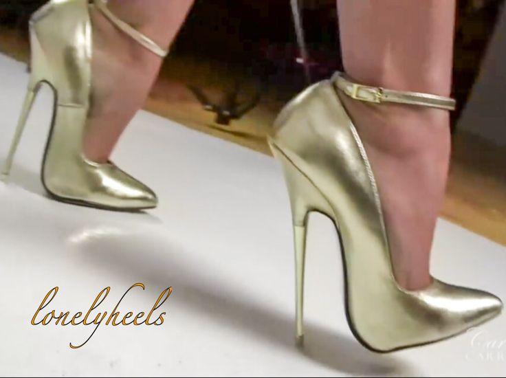 Gold metal stiletto pumps heels.