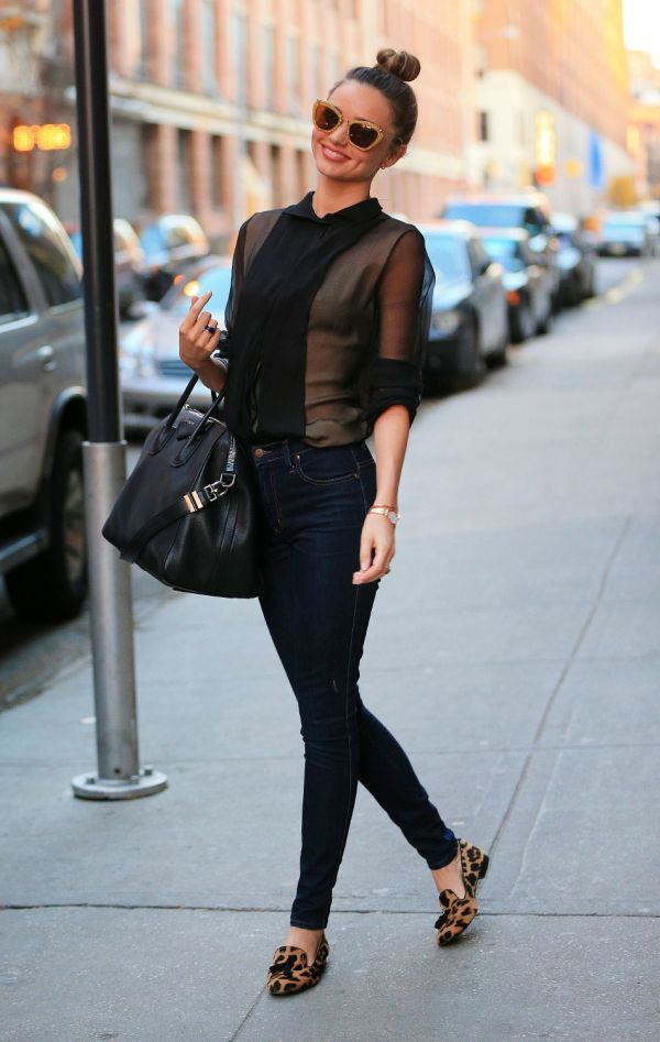 Shop Miranda Kerr's look for $112:  http://lookastic.com/women/looks/black-button-down-shirt-and-navy-skinny-jeans-and-black-shopper-handbag-and-brown-tassel-loafers/999  — Black Silk Button Down Shirt  — Navy Skinny Jeans  — Black Leather Shopper Handbag  — Brown Leopard Tassel Loafers