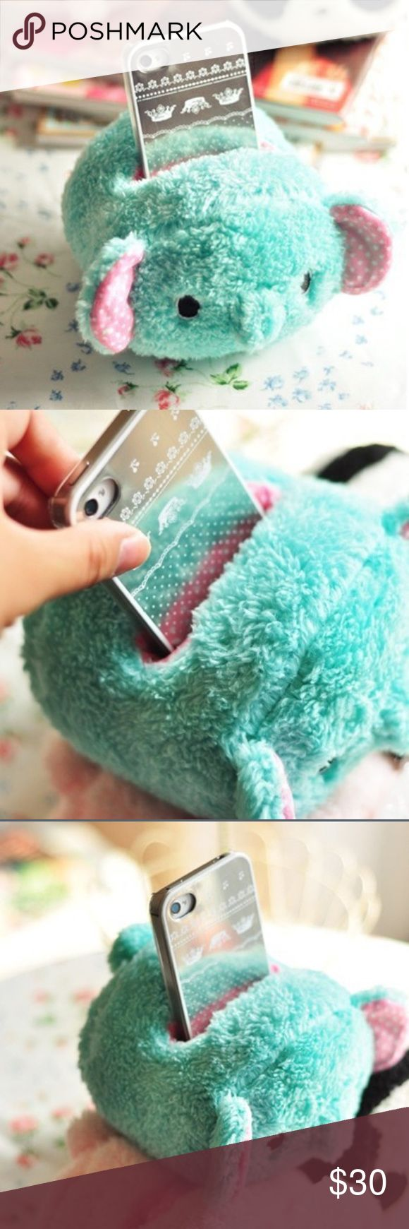 "Cute 🐘 Elephant Plush Cell Phone Holder Super Cute 🐘 Elephant Plush Cell Phone Holder & Stand. Cute design, soft & fluffy, and protects your phone! Put on table, bed, or any other place as decoration. Makes a perfect gift! 100% Brand New & Good Quality. BUNDLE & SAVE!  Approx. Size: 12*11.5*8.5cm/ 4.7""*4.5""*3.3""  Fits Phone Size: Phone width max to 7cm, most of latest phones are available, such as: Samsung S4, iPhone 6s, LG Nexus 5, HTC Desire 500, BlackBerry Z30, etc. Accessories"