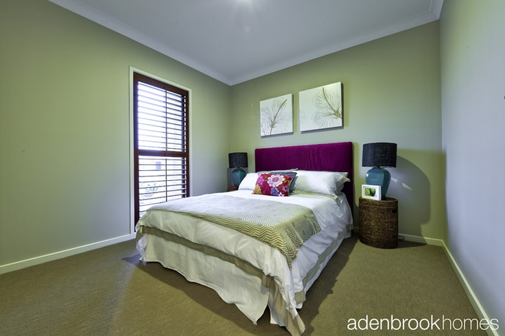 """Bedroom decorated in """"Resort Living"""" theme."""