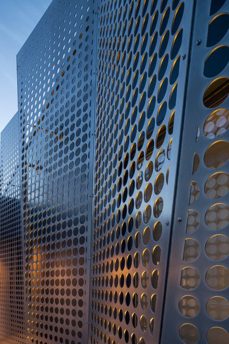 """Extension in Lund by Johan Sundberg Arkitektur, Lund, Sweden. Sheets of perforated metal to create a faceted facade. The architects designed the tactile and patterned facade to differentiate the offices from its """"mediocre"""" neighbours, and represent the construction business"""