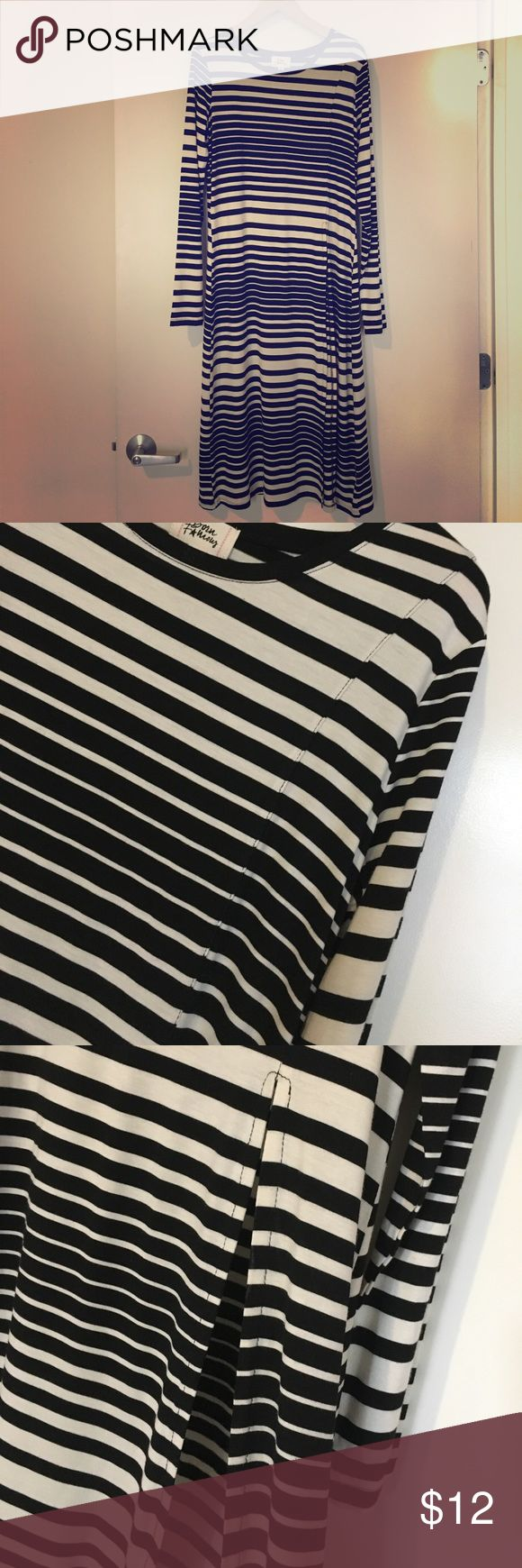 Striped Slit Long Sleeve Tunic/Duster White and black stripes featured on this fun tunic! High slit, seam detailing, long sleeves. 95% rayon 5% spandex. Looks great with leather leggings and boots! Never been worn. Tops Tunics