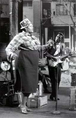 "Willie Mae ""Big Mama"" Thornton - Dec. 11, 1926 (Montgomery, AL). Singer, harmonica player, songwriter - Blues GREAT. First singer of Leiber  Stoller's ""Hound Dog"".  Was present at the infamous Johnny Ace death. Played a little drums too.  Known for wearing men's clothing. Passed away in Los Angeles - July 25, 1984, age 57.  In this picture: Buddy Guy on guitar."
