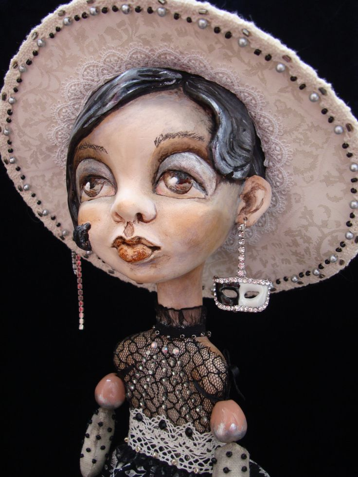 A personal favourite from my Etsy shop https://www.etsy.com/listing/511714663/domino-art-doll-black-and-white-interior