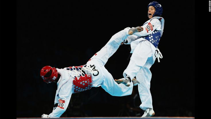 Seulki Kang, left, of the Central African Republic competes against Lucija Zaninovic of Croatia during the women's taekwondo under 49-kilogram preliminary round.