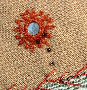 hi Sha surrounded with a combination of detached chain stitch and fly stitch sealed with a colonial knot…