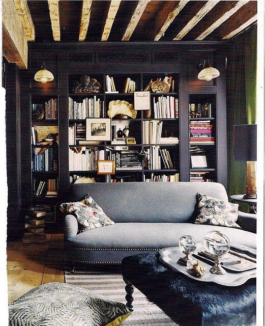 rustic raftered ceiling with black painted bookshelves, gray sofa - so gorgeous  www.yournestdesign.blogspot.com