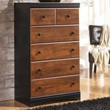 Ashley Aimwell Five Drawer Chest - With the rustic beauty of the warm brown finish enhancing the replicated cherry grain along with the deep black finish that features golden rub through accenting, the two-toned look of the Aimwell bedroom collection captures a vintage casual atmosphere to enhance any bedroom's decor.