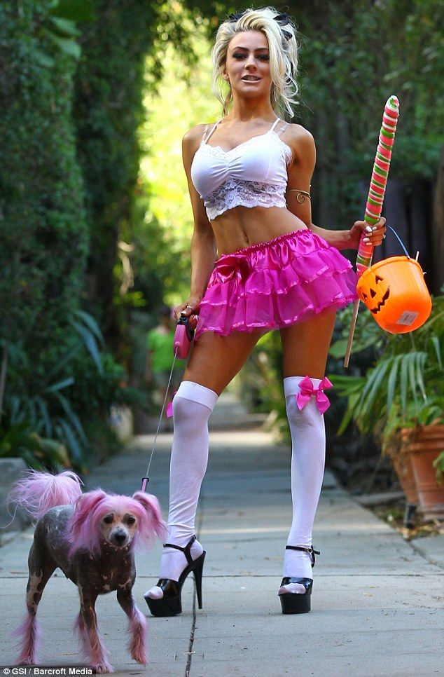The real deal: Courtney went as a very sexy version of herself, opting for a naughty school girl costume, consisting of super short hot pink skirt, a white lacy crop top, knee-high socks and stripper style heels