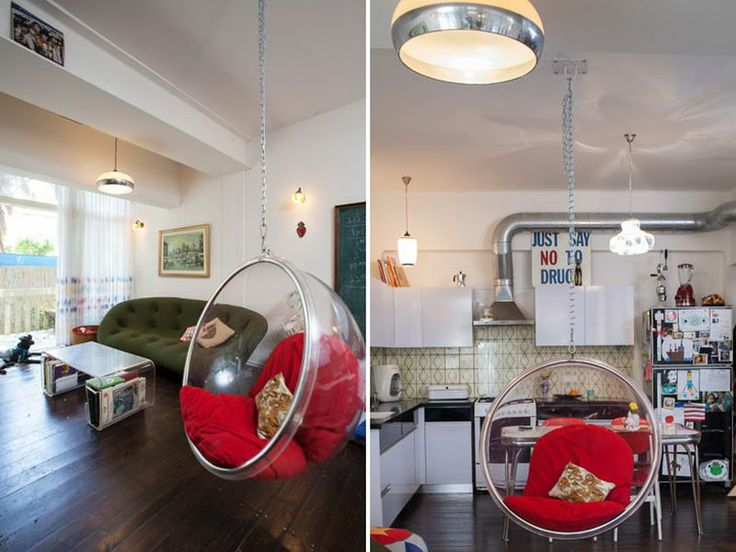 nostalgic renovated apartment with great interior iconic transparent bubble chair in the living room with the red cushions from the white c