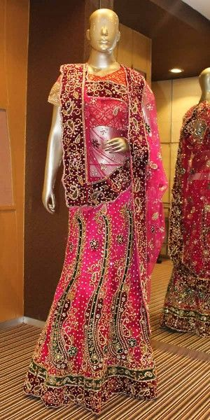 Eye-Catchy Pink Net Lehenga Choli With Dupatta.