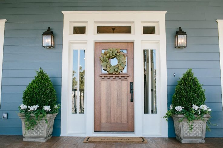 I love the front door and windows around it! -- Fixer Upper