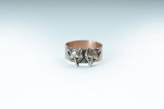 This is a solid bronze ring made in my studio. The little bears were originally a victorian stick pin or hat pin, about 100 years old. A replica of the original pin has been cast into bronze to make this ring! The ringband is also solid bronze, textured to match the little bears. The bears are small and detailed (may also be foxes...). Bear head size: 9 x 9 x 2 mm . I made the ring to look vintage and rustic with patina and texture! Very cute an unique! A ring to fall in love with! :) Ring…