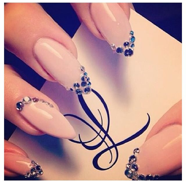 Nude medium length stilleto nails