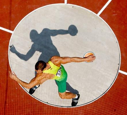 Sun & shadow Darius Draudvila of Lithuania in the discus throw during the decathlon