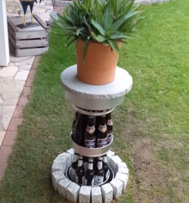 Cool Garden ornament rises out of lawn to reveal amazing hidden BEER FRIDGE