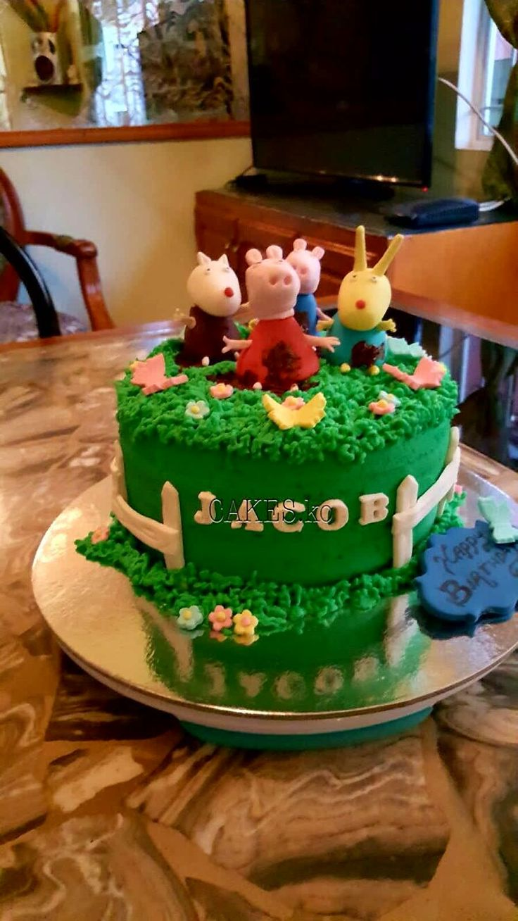 Birthday cake Peppa pig and her friends in mud puddles on buttercream chocolate cake. Click link to my business page for more of my work.
