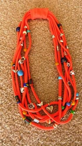 T-shirt necklace.  I really love this as a statement piece with a tank top or other simple shirt.  I love the bright color used here with all the different beads n stuff.