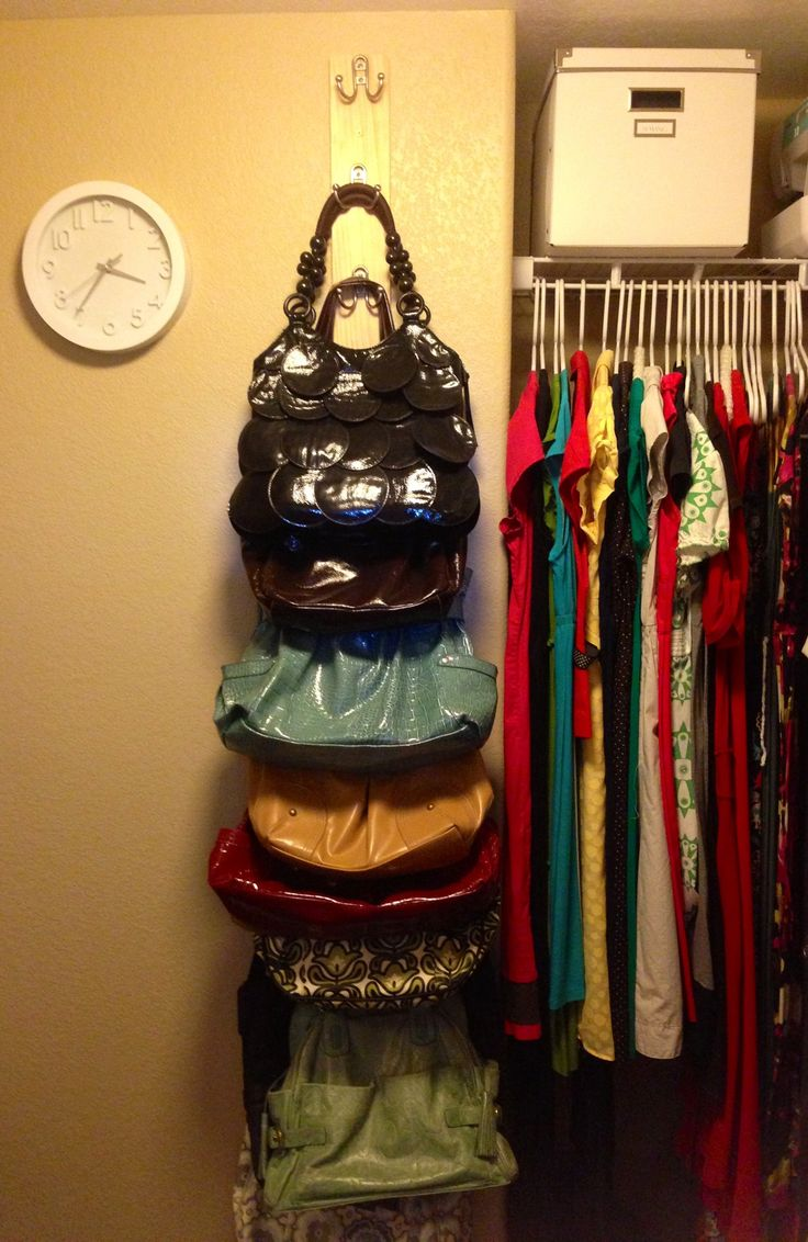Purse Rack DIY - Buy a long, wood board. Screw hooks on sideways. Easy, organized, bag storage.