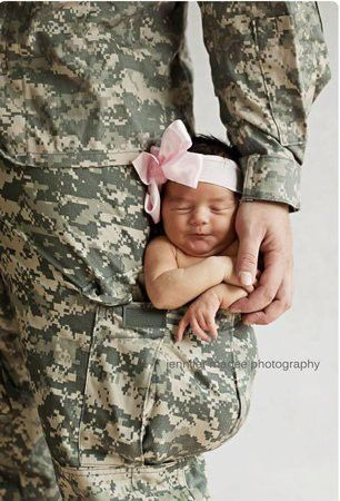 """I  this photo, the caption says: """"Daddy will always protect you baby girl"""" army"""