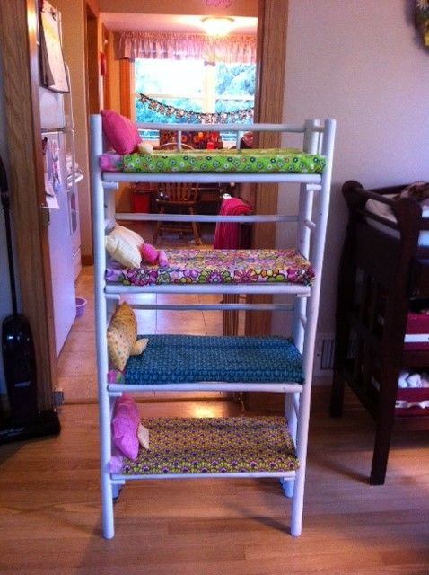 My daughters genius idea for beds for her American Girl dolls. A four tiered shelf, plus bedding I made!