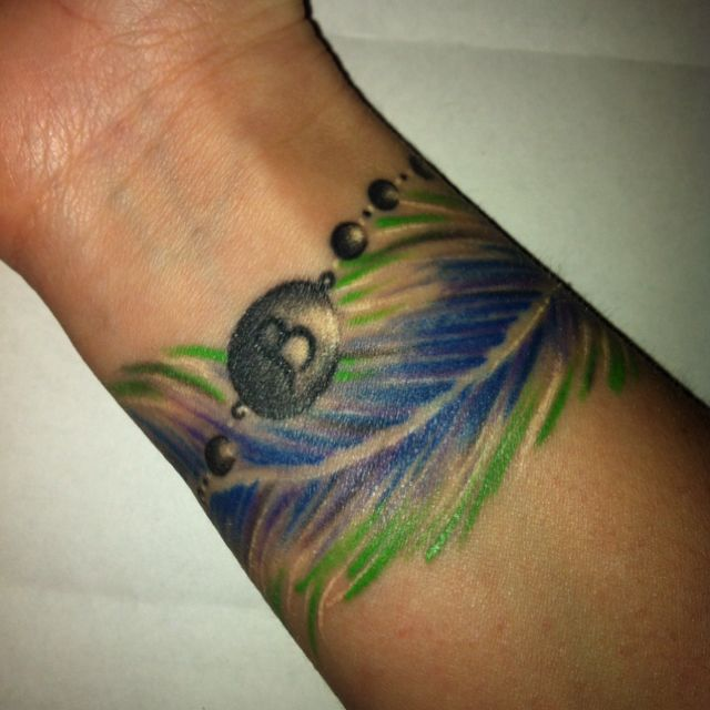 71 Attractive Stars Wrist Tattoos Design: My Feather/bracelet Tattoo