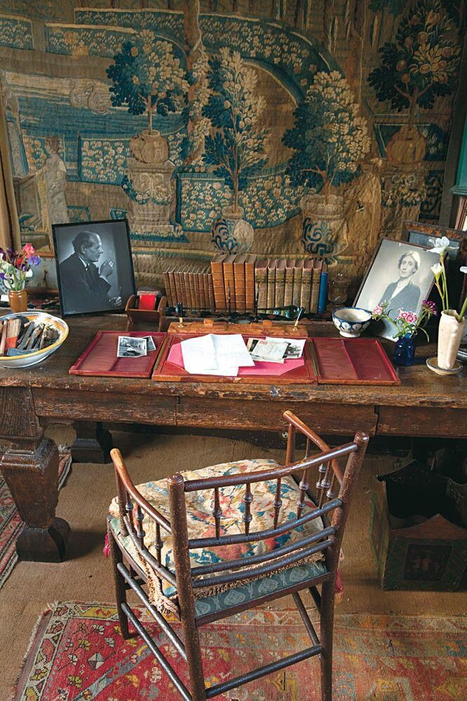 Photos are Harold Nicolson and Virginia Woolf, I think this is Vita Sackville-West's writing room in Sissinghurst Tower.