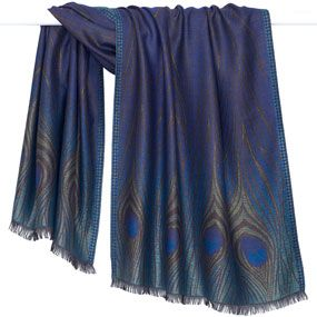 The shimmering design of our lush Peacock Feather Shawl was inspired by Louis Comfort Tiffany's (American, 1848–1933) iridescent glass vase produced by Tiffany Glass and Decorating Company in 1900.  Louis Comfort Tiffany was often compelled by the natural world, and this particular motif was used in some of his most important architectural commissions and ornamental vessels.
