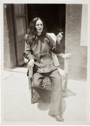 """Frida Kahlo after an operation, 1946, by Antonio Kahlo. The lingering pain from her Sept. 1, 1925, bus accident led to a series of operations throughout her life. Though she often dressed up in colorful traditional Mexican patterns and jewelry, with her hair up, she appears in this small image, taken by her nephew, looking quite different. On the rear of the photo is written: """"Frida right after surgery in 1946 - Coyoacan - she is now worse than ever, the pain is unimaginably intense."""""""