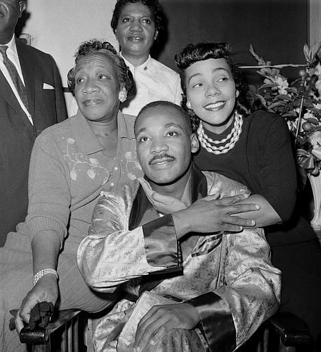 Dr. Martin Luther King, Jr.(1929-1968), is embraced by his wife Coretta Scott King (1927-2006) during a news conference at Harlem Hospital in New York, Sept 30, 1958, where he is recovering from a stab wound following an attack by a woman. At left is his mother, Alberta Williams King (1904-1974). (AP Photo/Tony Camerano)