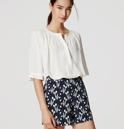 Who said tailoring can't be breezy? In fluid crepe, these vibrant floral shorts…
