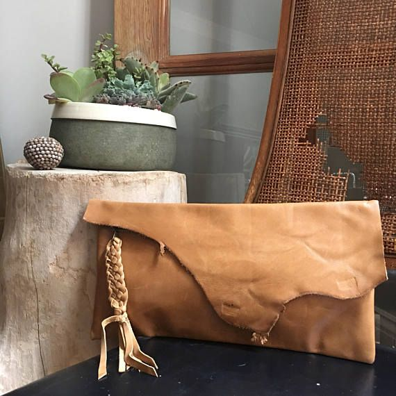 Raw Edge Clutch - Boho Clutch - Boho Style - Raw Edge Bag - Aged Rattan Leather Clutch - Braided Tassel - One of a Kind  From my Raw Collection ➤ Each bag from my Raw Collection is ONE OF A KIND! No two are exactly alike, as unique as the women who carry them.  Aged Rattan Leather. This is a beautiful clutch. Notice the natural organic shape of the flap and the pull marks at the center and right edge. The are the unique qualities I look for when creating these clutches. Lined in a linen/...