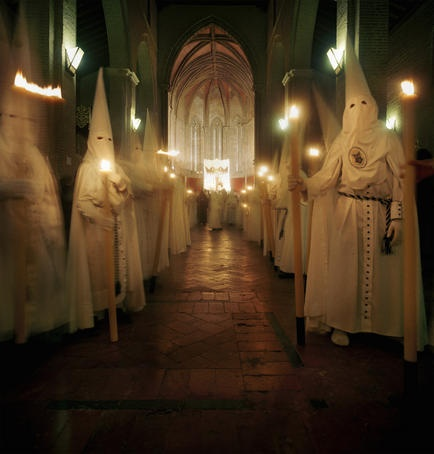 Devout Catholics in Sevilla, Spain during Semana Santa- Everyone should see one of the processions they have at night. It is a little creepy for us Americans at first, but you get over it. Great experience.