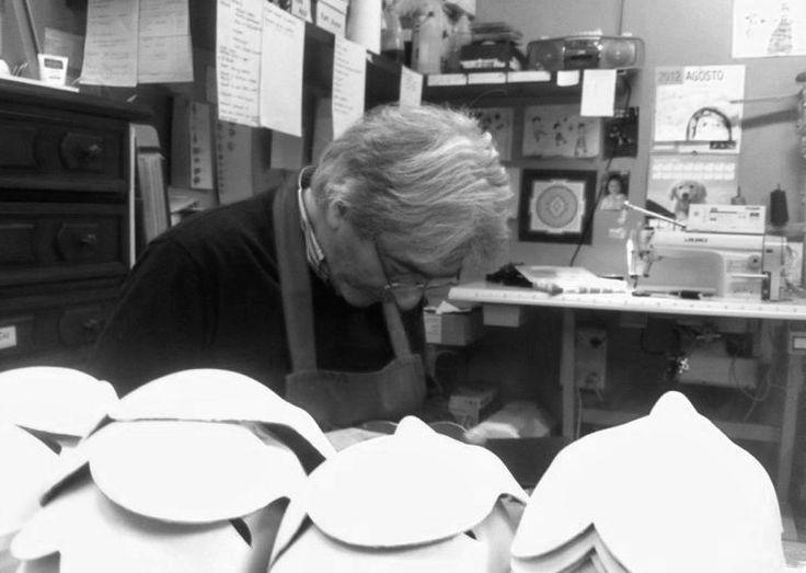 Carlo marega working in his atelier on his handmade papier-maché Venetian masks.  www.marega.it