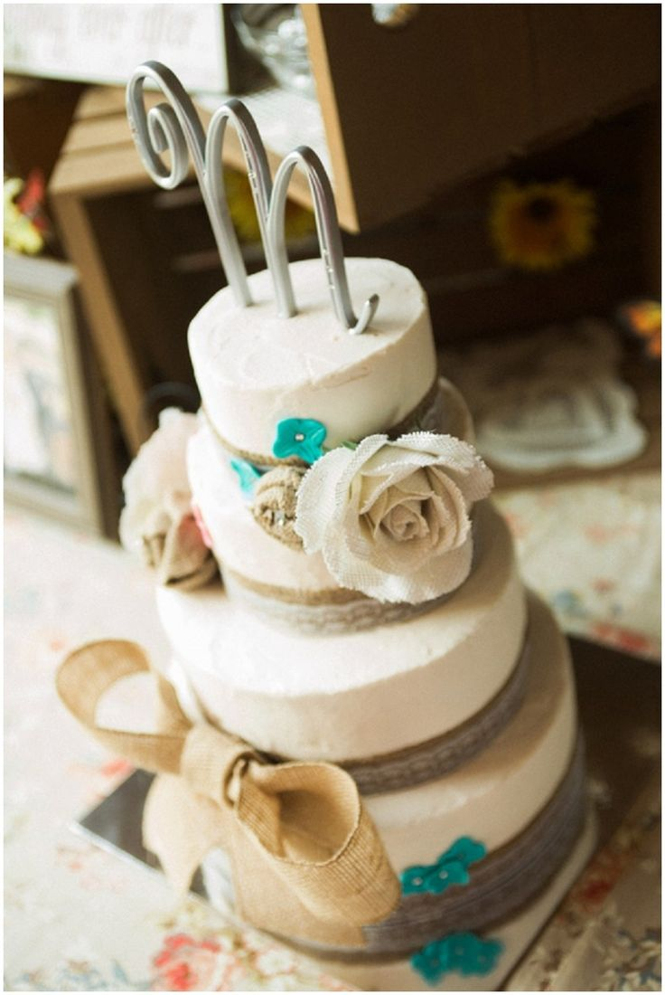 rustic wedding cake design with burlap accents and flowers