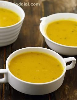 This creamy soup will surprise even the most brutal haters of pumpkin and surely bowl over the most critical palatte. Instead of using cream,i've mixed corn flour with low-fat milk to thicken the soup and impart a delectable creamy texture.