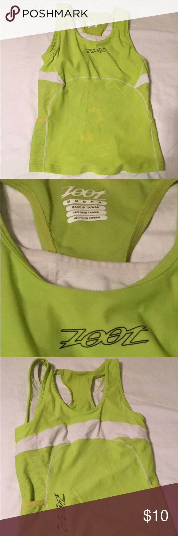 Zoot triathlon, cycling or running top This has only been worn once! High quality company, Zoot, famous for triathlon clothing but can also be used for just cycling or running.  Has a very comfortable and stable shelf bra, and pockets for storage. You won't be disappointed with this top for your quality workouts! Zoot Tops