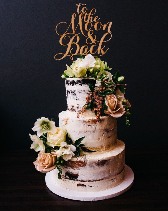 gold cake topper on naked cake