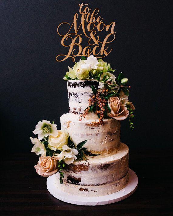 gold cake topper on naked cake