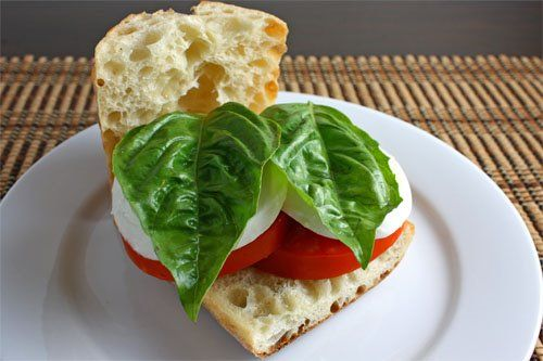 Caprese Sandwich with fresh mozzarella, basil leaves and tomatoes (Balsamic dressing can be added)