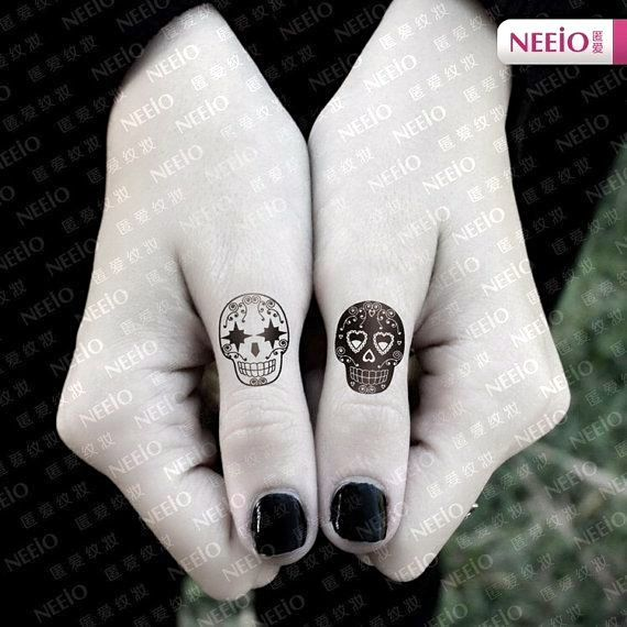 Not a real tattoo, but nice contrasting sugar skulls.