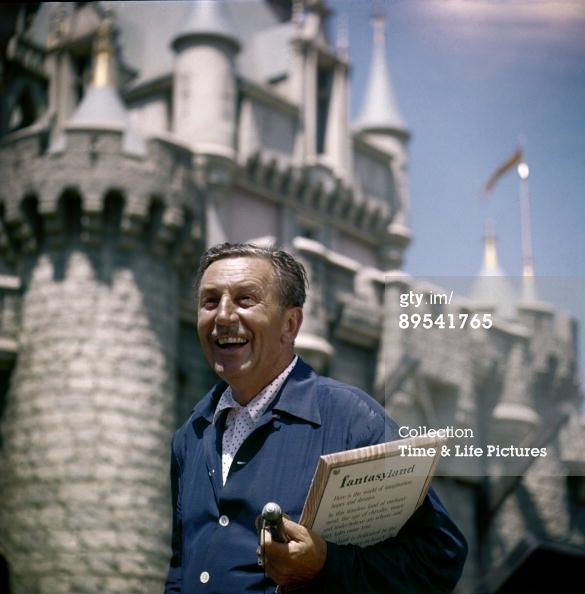 Walt Disney smiles as he stands in front of the Fantasyland castle at the grand opening of Disneyland, Anaheim, California July 17, 1955. (Photo by Allan Grant/Time & Life Pictures/Getty Images)