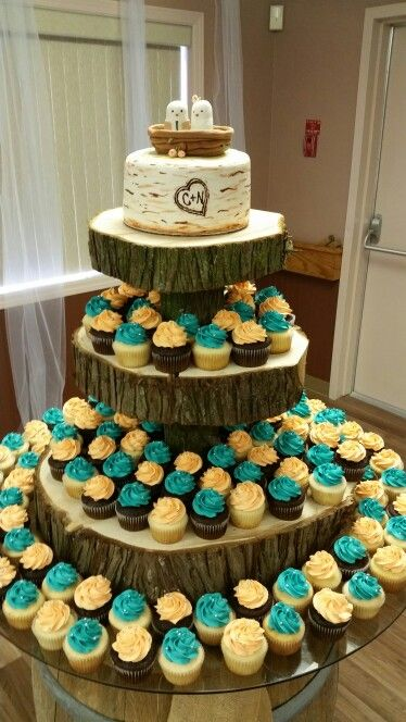 Rustic teal and coral wedding cake and cupcakes.