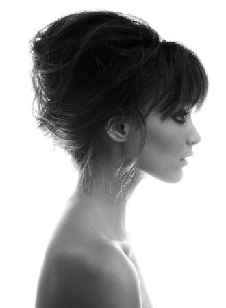 Amazing updo, especially love the bangs and the way that they frame the face.