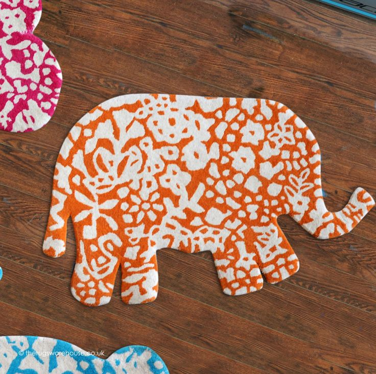 Appu Rug, an orange & ivory elephant shaped wool children's rug (hand-tufted, 100% wool) http://www.therugswarehouse.co.uk/kids-rugs/appu-rug.html #kidsrugs #childrensrugs #nurserydecor