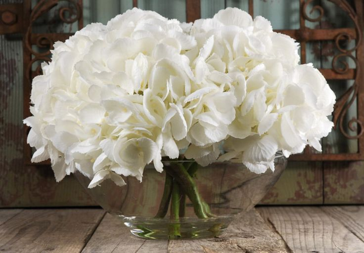 Simple yet beautiful! -- Silk Hydrangeas in Glass Vase with Faux Water White Flowers from Save on Crafts